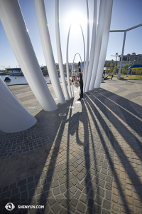 Meanwhile, in Australia's Perth… dancer Fadu Chen echoes the shapes of shadows by the harbor. (photo by dancer Stephanie Guo)