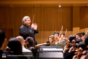 Conductor Milen Nachev leads the roughly 100 Shen Yun musicians in rehearsal prior to the opening performance, a matinee, immediately followed by an evening performance. (photo by TK Kuo)