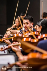 Principal violinist Stepan Khalatyan is the only one cooperating with the cameraman during this rehearsal at the Taichung Chung Hsing Hall, Taiwan.