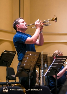 Principal trumpeter Eric Robins warms up before the performance at Taiwan's Chiayi City Cultural Center Music Hall.