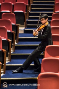 Violist Tongsheng Ye warms up at Taoyuan's Zhongli Arts Hall, Taiwan.