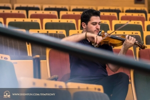 Principal violinist Stepan Khalatyan practices in the audience at Taiwan's Yilan Performing Arts Center.