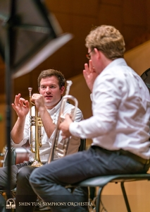 Trumpeters Eric Robins (left) and Jimmy Geiger deliberate the fine details of a trumpet part. (Photo by TK Kuo)