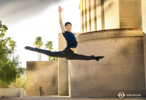 Dancer Aaron Huynh gets good height while leaping outside the Tucson Music Hall. (Photo by Principal Dancer Kenji Kobayashi)