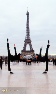 We're so excited to be in Paris! Flanking the 130-year-old Eiffel Tower are dancers Olivia Zhang (left) and Elsie Shi. (Photo by percussionist Tiffany Yu)