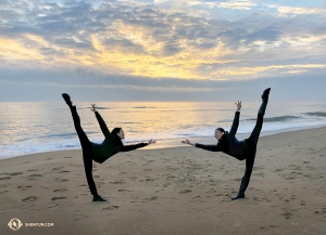 Too cold to swim, but we can still hit the beach dancer-style. Shen Yun Global Company enjoys an early morning sunrise at Virginia Beach. (Photo by emcee Victoria Zhou)