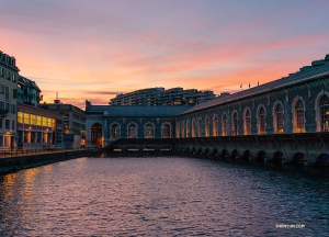An illuminated Bâtiment des Forces Motrice at dusk. (Photo by Andrew Fung)