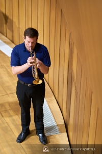 Trumpet player Eric Robins warms up.