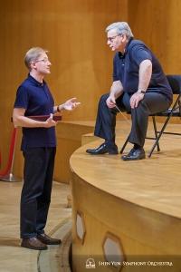 Conductors Milen Nachev and Dmitry Russu in discussion.