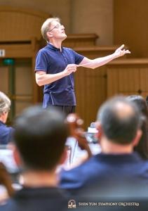 Conductor Dmitry Russu leads rehearsal.
