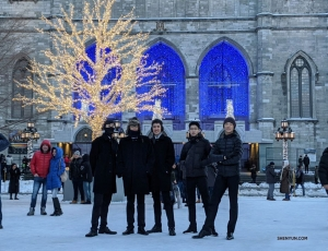 Dressed for the weather, dancers pose together in front of the well-known church located in the historic district of Old Montreal.  (Photo by dancer Ben Chen)