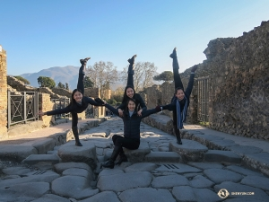 Sophie Xie offers her fellow dancers (from left) Xindi Cai, Ceci Wang, and Jenni Song support while they balance on the city that was well preserved by the ash from the eruption of Mount Vesuvius in 79 A.D. 
