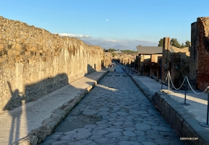 A glimpse of the distant moon down one of the roads in Pompeii.