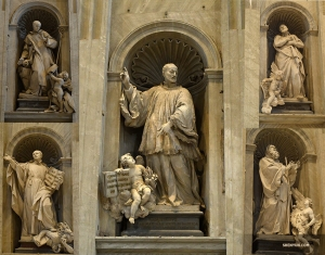 Intricate statues of Christian saints adorn the inside of St. Peter's Basilica.