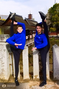 Dancers Lee Rubacek (left) and Stanley Lin hold their legs as straight as stone fence posts.