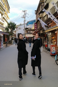 Typical ladies, Principal Dancers Melody Qin (left) and Michelle Lian head off to check out the shops.